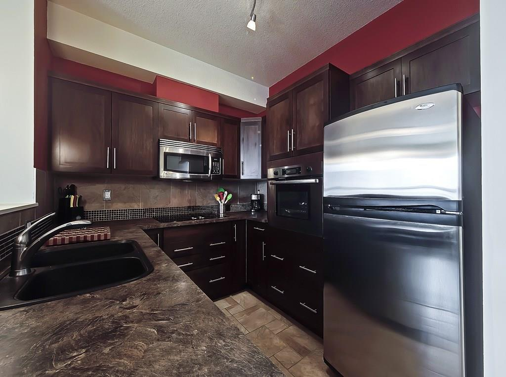 springbank hill calgary condo listing kitchen view westside sold