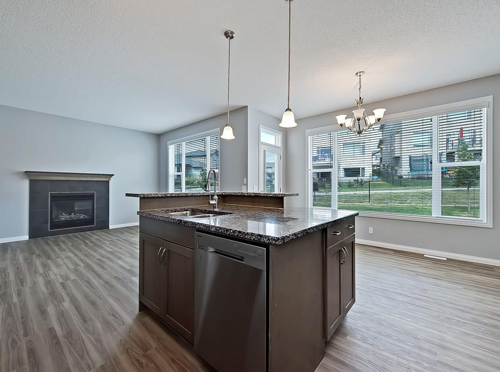 cochrane real estate listing 4 sunset ridge TC living area kitchen